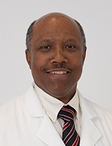 Photo of George W. Moore, M.D., M.Sc., FACPM, FACOEM